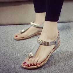 Summer casual scrub PU material thong low-heeled flat shape of the word style buckle with European styles of ladies shoes metal decorate sandals